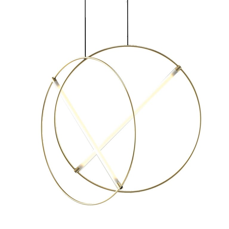 This exquisite ceiling lamp uses pure geometric shapes to create a striking light fixture that will have an arresting effect in any room it is placed. Its structure is made of one brass circular tube, inside of which one straight fluorescent light