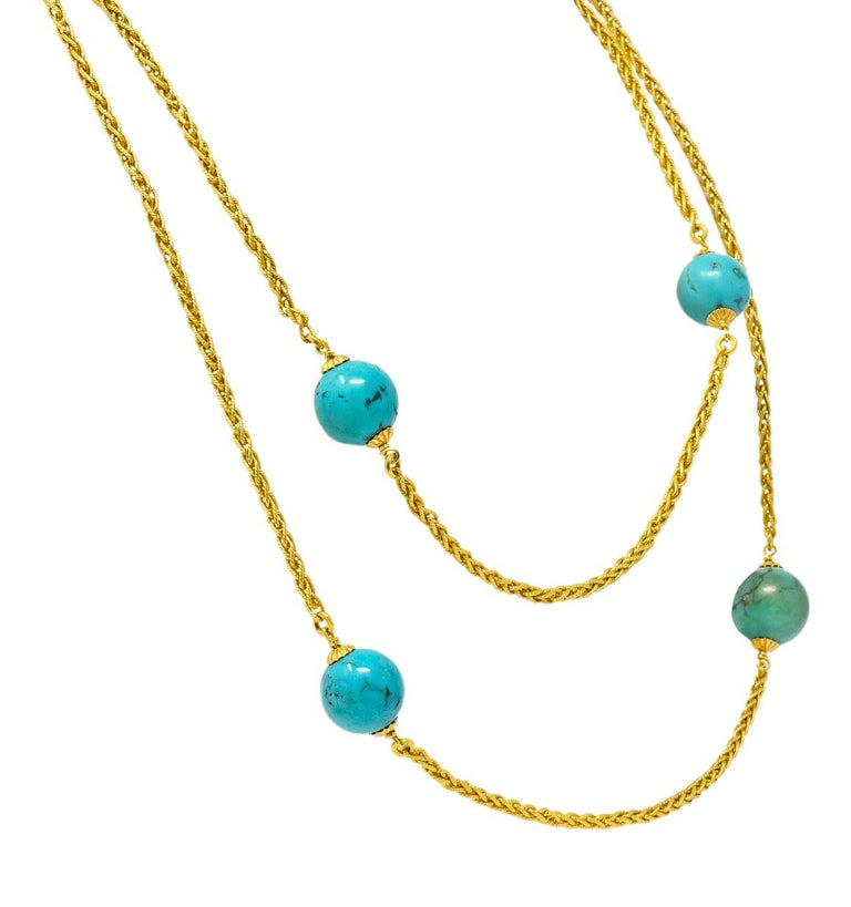 With eight round turquoise beads measuring from 13.0 mm to 15.0 mm, of varying hues of blue green and with visible matrix  Station set with twisted gold, square wheat style chain between  Completed by a barrel clasp  Tested as 18 karat gold  Length: