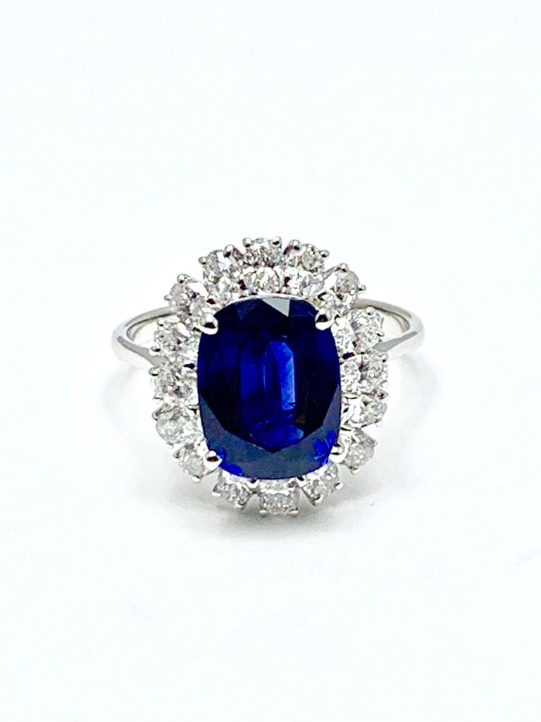 A stunning 4.60 carat cushion mixed cut Sapphire and diamond cocktail ring set in 18 karat white gold.  The Sapphire is prong set with 16 oval brilliant Diamonds surrounding, consisting of 1.28 carats total weight.  The Sapphire has bee graded by