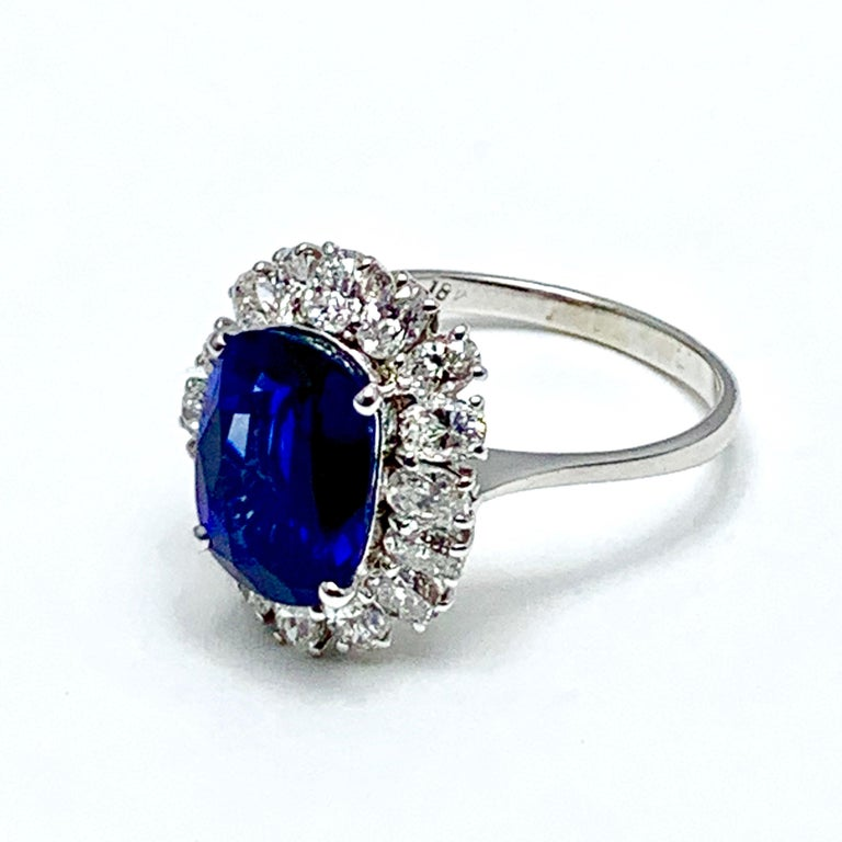 Modern 4.60 Carat Cushion Cut Sapphire and Oval Diamond Halo White Gold Cocktail Ring For Sale