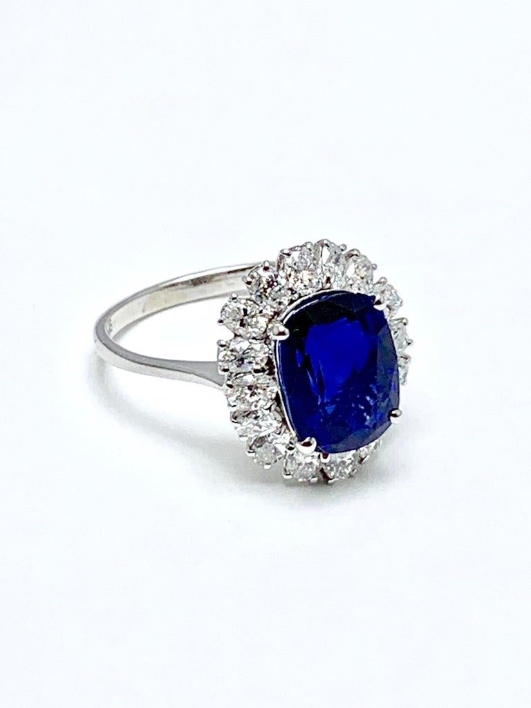 Women's or Men's 4.60 Carat Cushion Cut Sapphire and Oval Diamond Halo White Gold Cocktail Ring For Sale