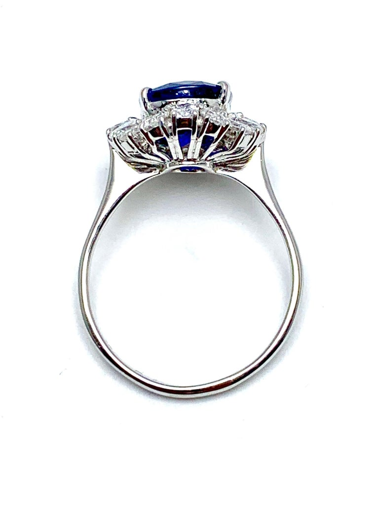 4.60 Carat Cushion Cut Sapphire and Oval Diamond Halo White Gold Cocktail Ring For Sale 1