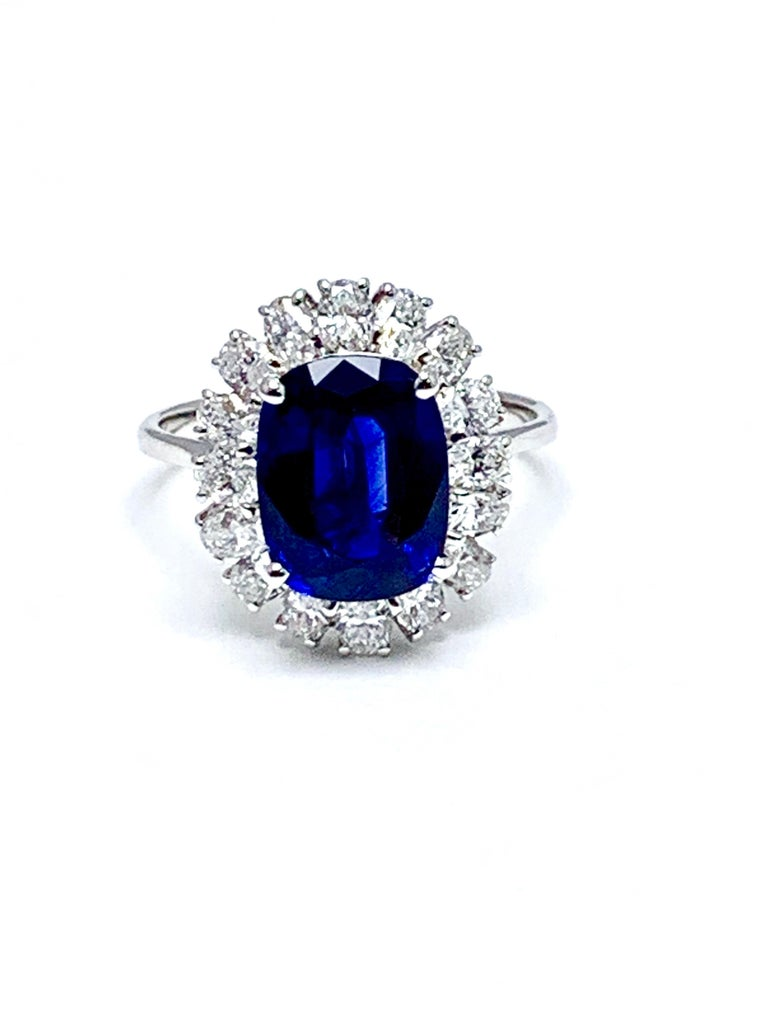 4.60 Carat Cushion Cut Sapphire and Oval Diamond Halo White Gold Cocktail Ring For Sale 3