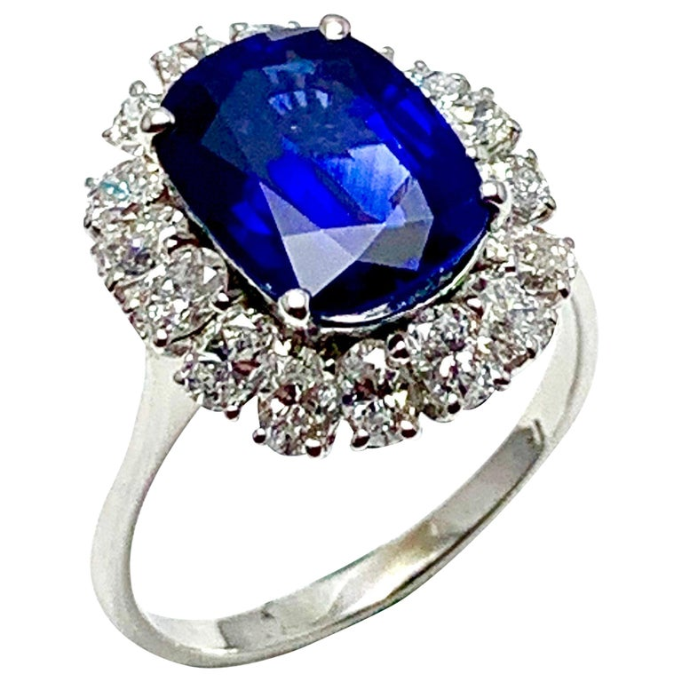 4.60 Carat Cushion Cut Sapphire and Oval Diamond Halo White Gold Cocktail Ring For Sale