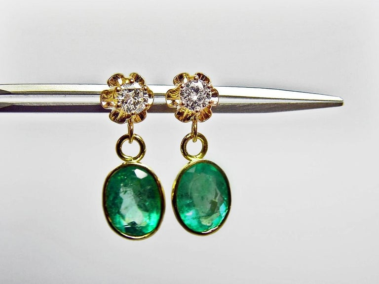 Timeless 4.60 Carat Estate Natural Colombian Emerald and  Diamond Dangle Drop Earrings 18K Yellow Gold  Primary Stones: 4.00cts 100%Natural Colombian Emeralds Shape or Cut :  Oval Cut Average Color/Clarity Emerald : Medium Green Color/ Clarity VS