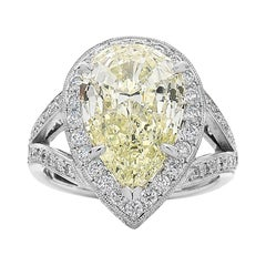 4.60 Carat Pear Shape Yellow Diamond Halo Engagement Ring