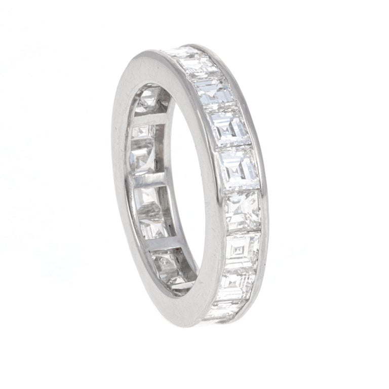 Platinum asscher cut diamond eternity band. Each diamond is white in color and eye clean. The diamonds are channel set and match perfectly in size. This is a perect engagement ring and/ or band that can be worn by a man or woman. There is a total of