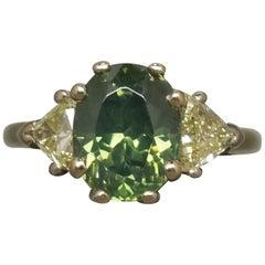 4.61 Carat Oval Green GIA Zircon and Trillion Cut Diamond Three-Stone Ring