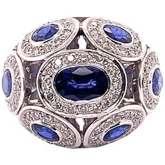 4.63 Carat Blue Oval Sapphire and Diamond Ring