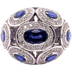 4.63 Carat Blue Oval Sapphire and Diamond Ring
