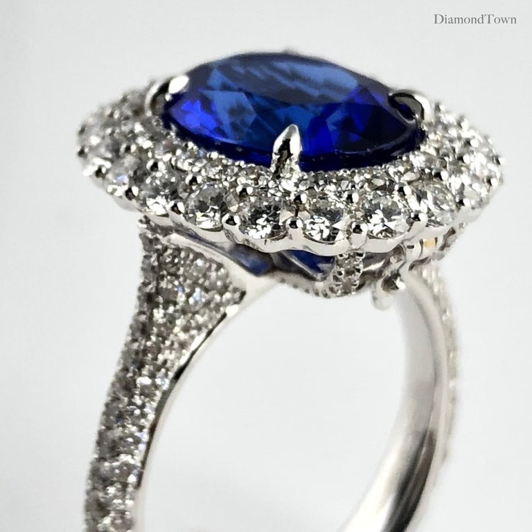 Contemporary 4.64 Carat Oval Cut Tanzanite and Diamond Halo Ring For Sale