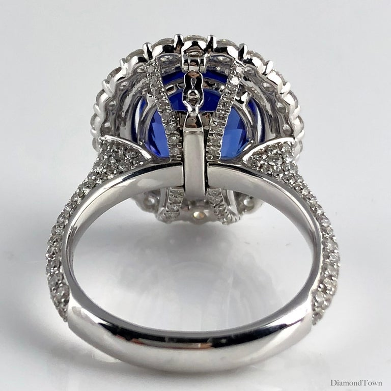 4.64 Carat Oval Cut Tanzanite and Diamond Halo Ring In New Condition For Sale In New York, NY