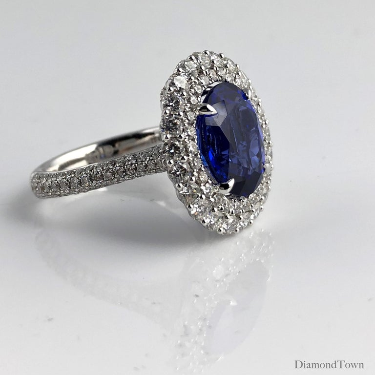 Women's 4.64 Carat Oval Cut Tanzanite and Diamond Halo Ring For Sale