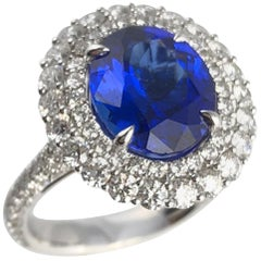 DiamondTown 4.64 Carat Oval Cut Tanzanite and Diamond Halo Ring