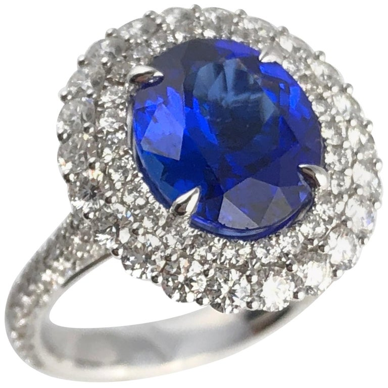 4.64 Carat Oval Cut Tanzanite and Diamond Halo Ring For Sale