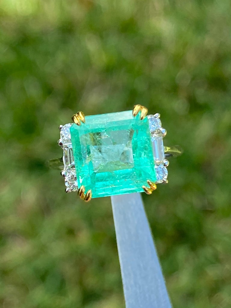 Centering a 4.65 Carat Emerald-Cut Colombian Emerald, accented by 0.66 carats of Round-Brilliant Cut and Baguette Tapered Cut White Diamonds, and set in 18K White Gold, this cocktail ring is a Gad & Co favorite!  Details ✔Gemstone: Emerald ✔Gem