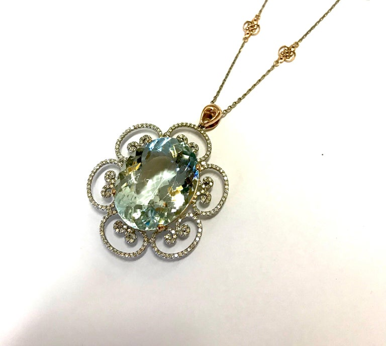Contemporary 46.53 Carat Oval Shaped Aquamarine and White Diamond Floral Pendant For Sale