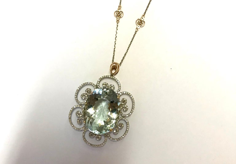 Oval Cut 46.53 Carat Oval Shaped Aquamarine and White Diamond Floral Pendant For Sale