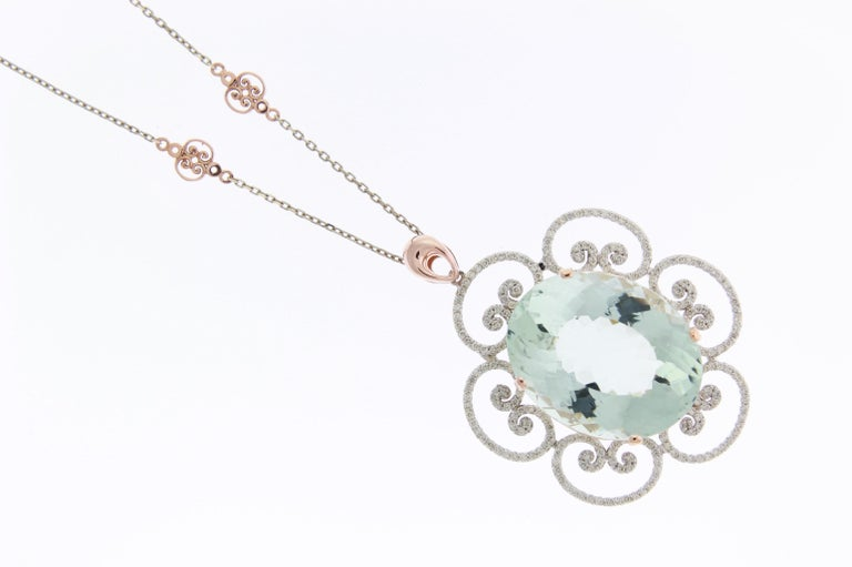 46.53 Carat Oval Shaped Aquamarine and White Diamond Floral Pendant In New Condition For Sale In GREAT NECK, NY