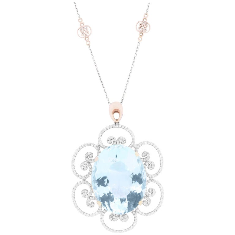 46.53 Carat Oval Shaped Aquamarine and White Diamond Floral Pendant For Sale
