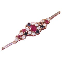 4.66 Carat Yellow Gold Diamond Ruby Sapphire Bracelet