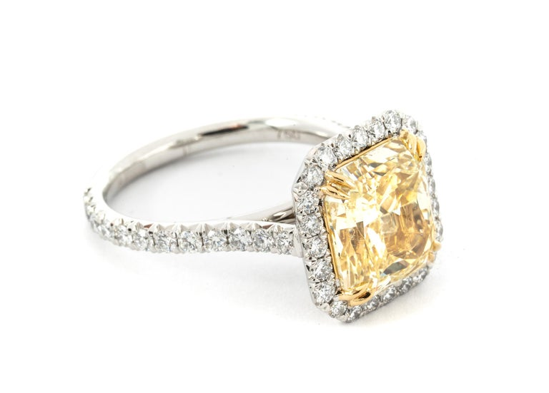 4.68 Carat Fancy Yellow Radiant Cut Diamond Ring GIA Grading report Included ( # 15321851 )  Ring is highlighted with  48 round diamonds weighing .87 carats total , G Color Vs Clarity   Summary: Center: .4.68 Ct Radiant Cut Fancy Yellow Ring Size: