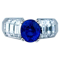 4.70 Carat Oval Sapphire and Diamond Ring Invisible Style 18 Karat VS Quality