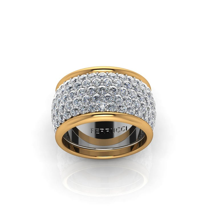 Wide diamond pave' ring, with a slightly dome feeling, a wrap of sparkling white diamonds adorned by the beauty of 18k yellow gold bands, for an approximate total carat weight of 4.70 carats, hand made in New York City by hand by  Italian master
