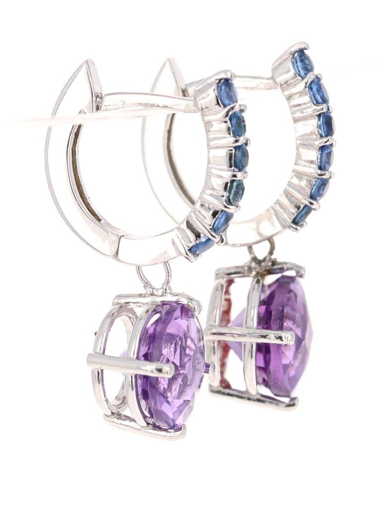 Modern 4.73 Carat Amethyst and Blue Sapphire Drop Earrings 14 Karat White Gold For Sale