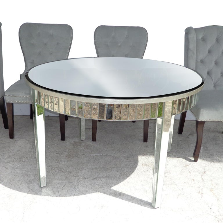 Hollywood Regency style mirrored table and chairs by Z Gallerie  Fully mirrored 47.5? dining table with 4 arm and side chairs.  Measures: Table : 47.75? Diameter x 30? Height  2 Archer dining chairs: Wing back chairs : 23? Width x 24? Depth x