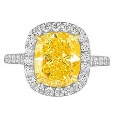4.76 Carat Cushion GIA Certified Fancy Vivid Yellow Diamond Two Color Gold Ring