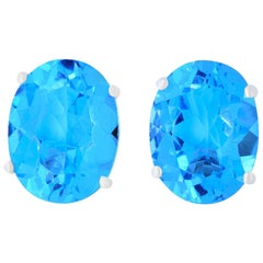 4.77 Carat Oval Blue Topaz Stud Earrings