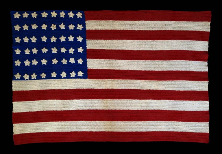 48 STARS ON A CROCHETED ON AN AMERICAN FLAG MADE DURING THE WWI - WWII ERA, A BEAUTIFUL EXAMPLE WITH STRIKING COLORS:  Beginning around the turn of the century, it became popular to make American flags from various forms of needlework, primarily by