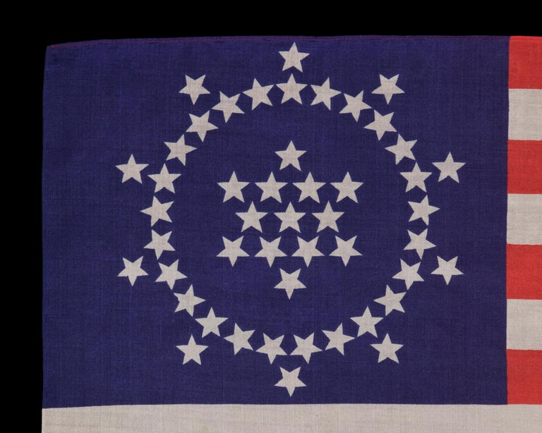 48 stars on an antique American Flag designed and commissioned by Wayne Whipple, 1911-1912, a rare and highly desired, silk example 