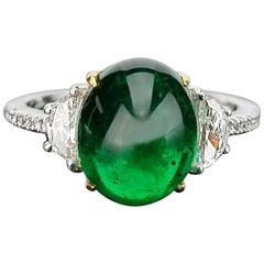 4.80 Carat Emerald Cabochon and Diamond Three-Stone Ring