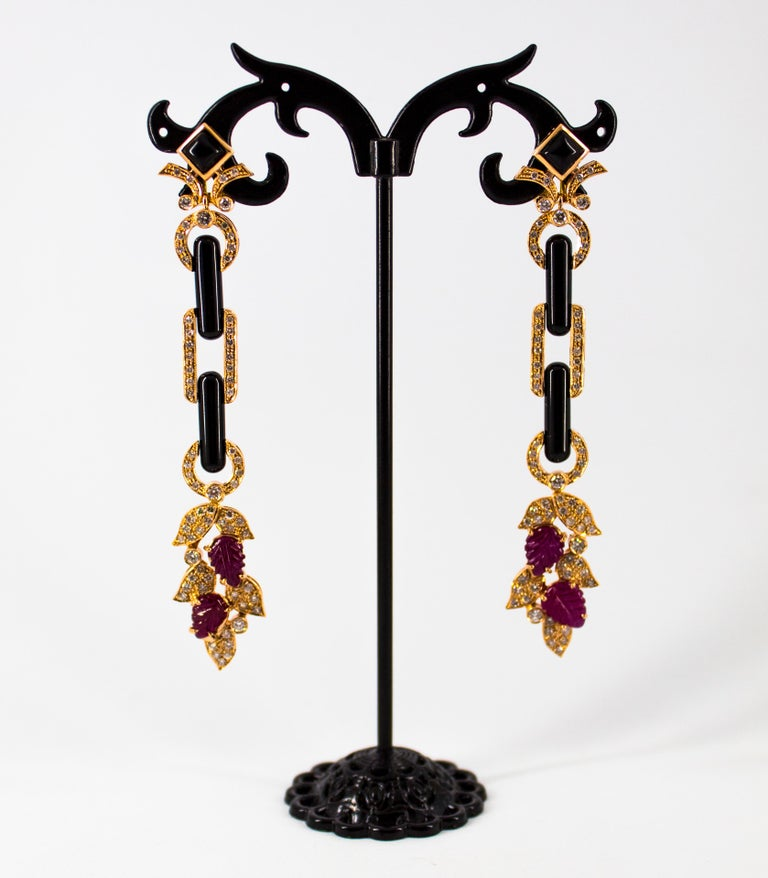 These Earrings are made of 14K Yellow Gold. These Earrings have 1.76 Carats of White Diamonds. These Earrings have 4.80 Carats of Rubies. These Earrings have also Onyx. All our Earrings have pins for pierced ears but we can change the closure and