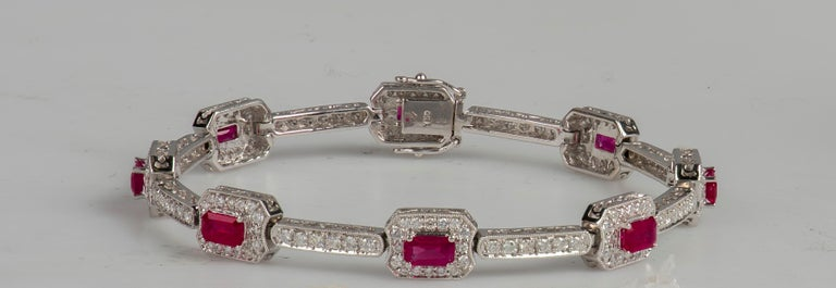4.82 Carat Total Weight Emerald Cut Rubies Bracelet with 2.21 Carat Diamonds For Sale 1