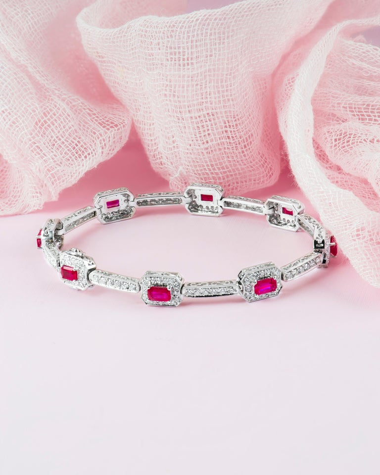 4.82 Carat Total Weight Emerald Cut Rubies Bracelet with 2.21 Carat Diamonds In New Condition For Sale In Houston, TX
