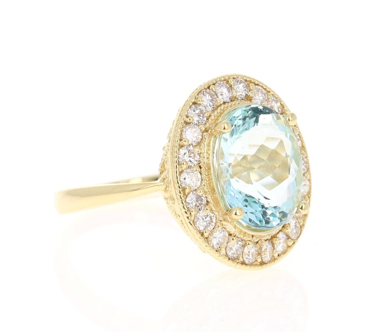 Stunning Victorian-Inspired Beauty!  This ring has a beautiful 4.07 Carat Oval Cut Aquamarine and is surrounded by 22 Round Cut Diamonds that weigh 0.77 carat (Clarity: VS, Color: H). The total carat weight of this ring is 4.84 Carats.   The Oval
