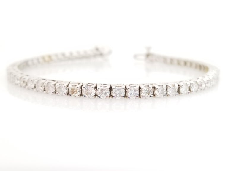 Brilliant and beautiful, set on 14K white gold. each stone is set in a classic four-prong style for maximum light brilliance. Everyday elegance.  7 inch length.  Average Color H, Clarity VS,  3.3 mm wide. 14 Karat White Gold