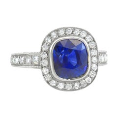 4.86 Carat Cushion Cut Blue Sapphire Ring in Platinum with 1.15 Carat Diamonds