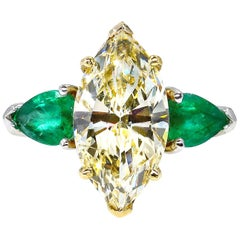 4.86ct Natural Fancy Yellow Marquise Diamond and Green Emerald Plat/YG Ring EGL