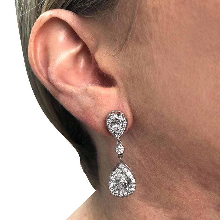 Pear Cut 4.87 Carat Diamond Dangle Earrings For Sale