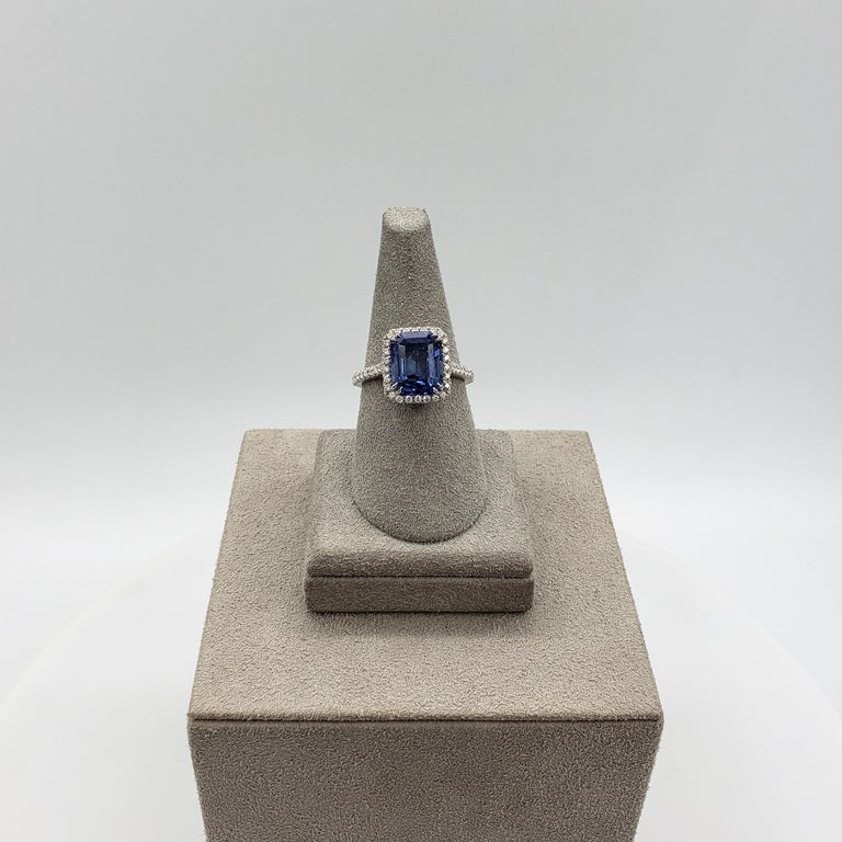 Modern 4.88 Carat Blue Emerald Cut Sapphire and Diamond Halo Engagement Ring For Sale
