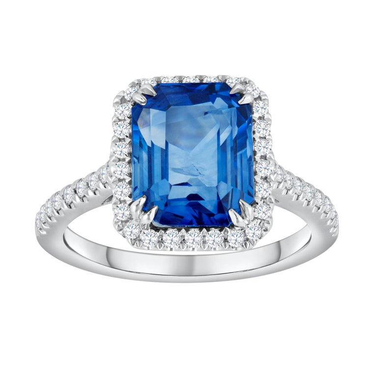 4.88 Carat Blue Emerald Cut Sapphire and Diamond Halo Engagement Ring For Sale