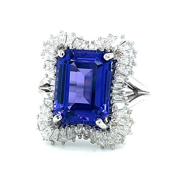 This stunning tanzanite and platinum ring is the one everyone will remember! The 4.89 carat emerald cut tanzanite literally sits center stage, framed by sparkling tapered baguette diamonds in this ever sparkling cocktail ring! The center stone has