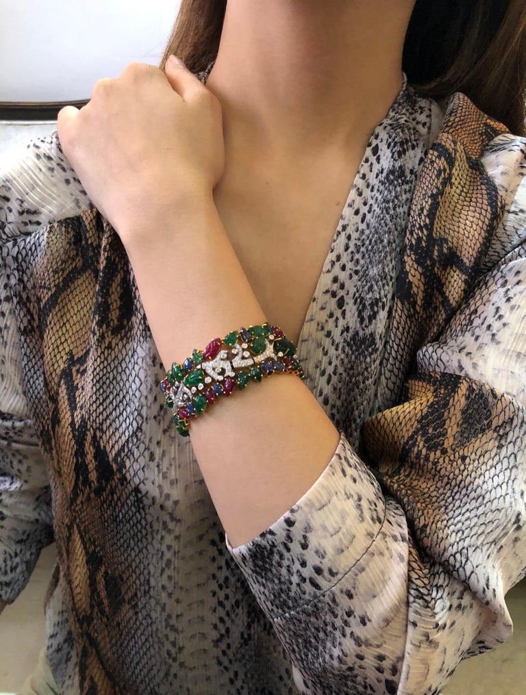 Painstakingly handcrafted by our artisans, this exquisite bracelet cuff features specially cut and carved natural emeralds, rubies and sapphires and diamonds  Rubies, emeralds, sapphires, diamonds   Diamonds- 3.49 carats  Emerald, Ruby, Sapphire-