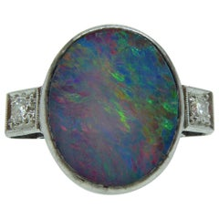 4.96 Carat Boulder Opal Ring with 0.16 Carat Diamond Set Shoulders