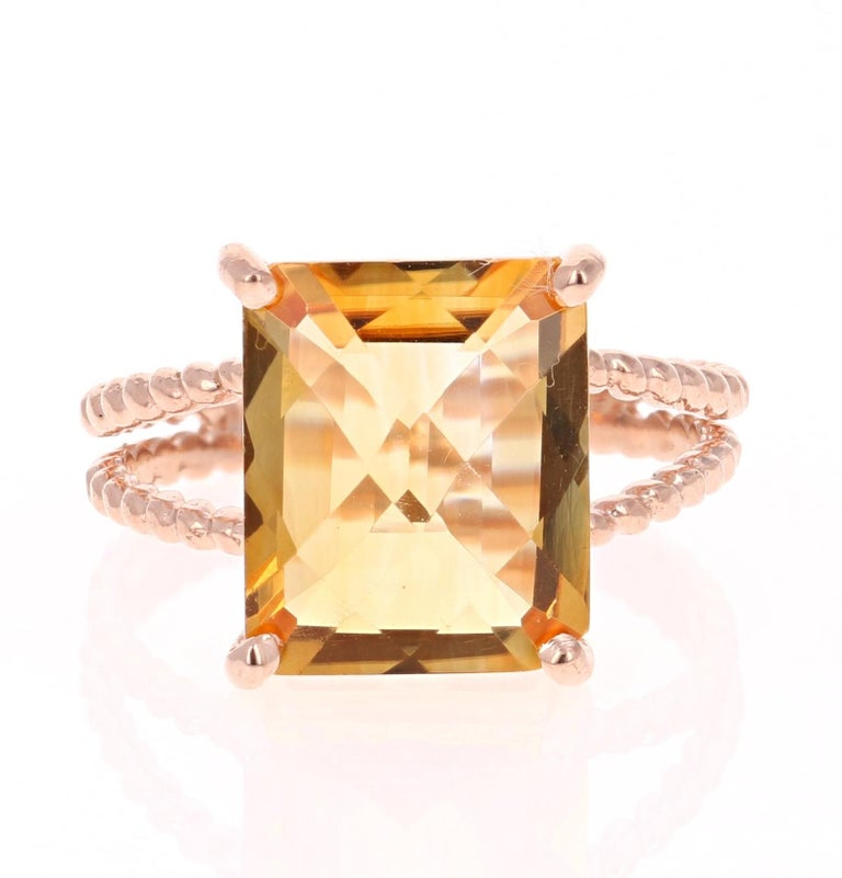 This beautiful and simple ring has a bright and vivid Emerald Cut Citrine Quartz in the center that weighs 4.99 carats.  The setting is beautifully crafted in 14K Rose Gold and weighs approximately 3.2 grams. The ring is a size 7 and can be re-sized