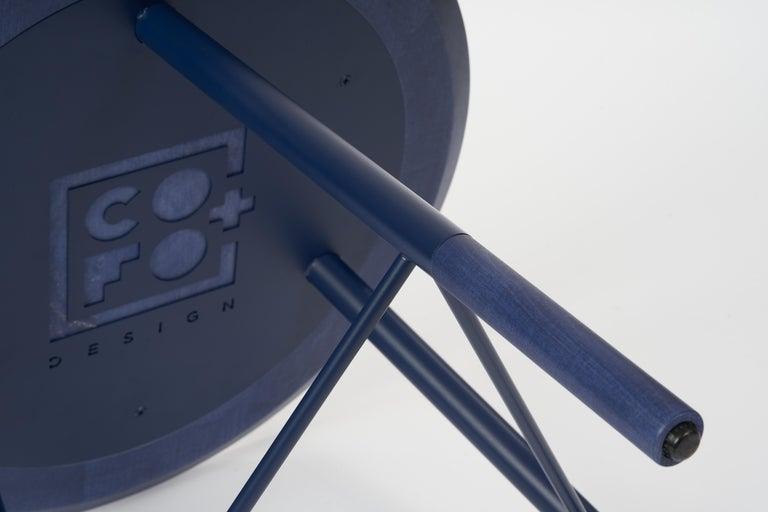 Frame: Laser-cut, welded cold-rolled steel frame. Custom eco-friendly matted powder-coat finish.   Wool Hammock Shelf: Removable premium Italian Melton wool hammock.   Details: Commercial grade COFO Signature laser cut base